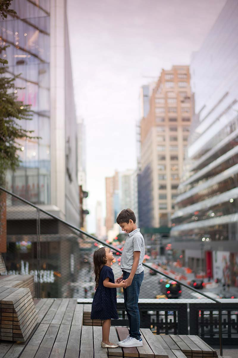 Brother and sister holding hands at the iconic Highline Park in New York City