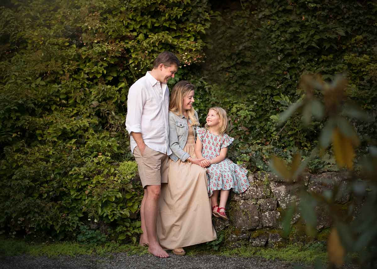 A family photo set amidst vines in Easthampton NY