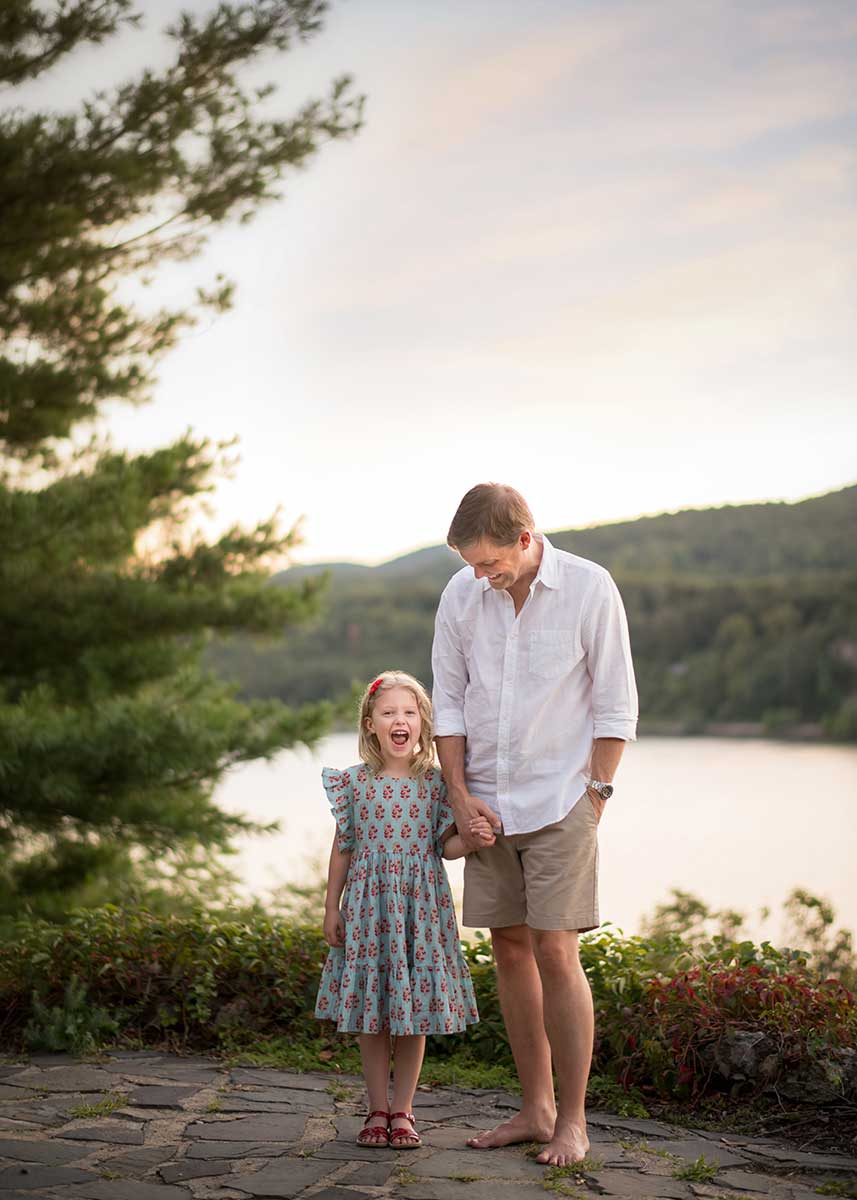 Father holding the hand of his young daughter near the Hudson River, NY