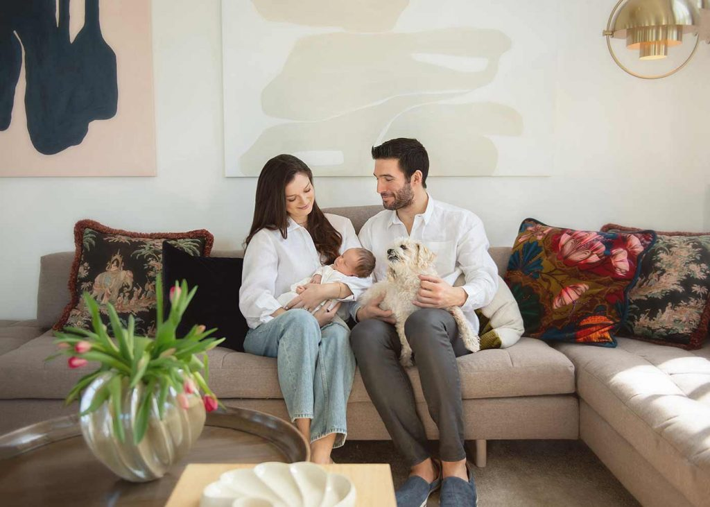 Mother and Father sharing a moment with their newborn baby at their NYC condominium