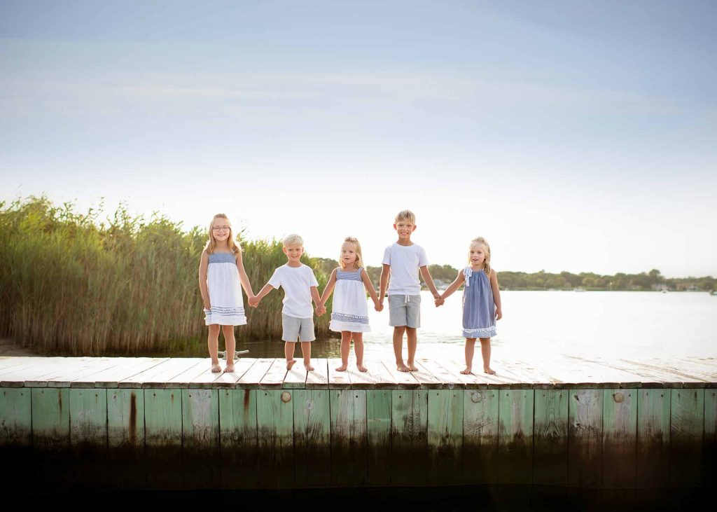 Group of children holding hands on a boat dock near Sag Harbor, NY