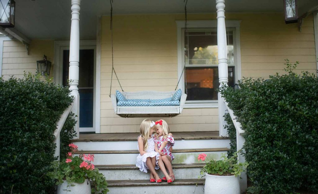 Sisters sharing a laugh on the porch of their Bridgehampton NY home