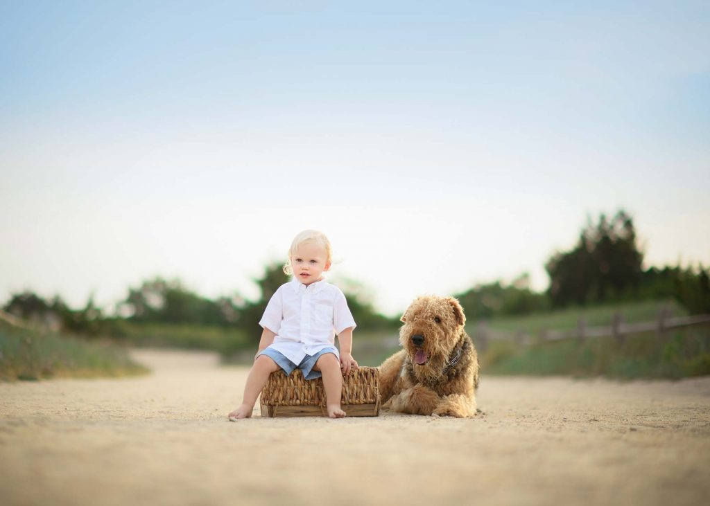 A toddler and his dog in the Hamptons, NY