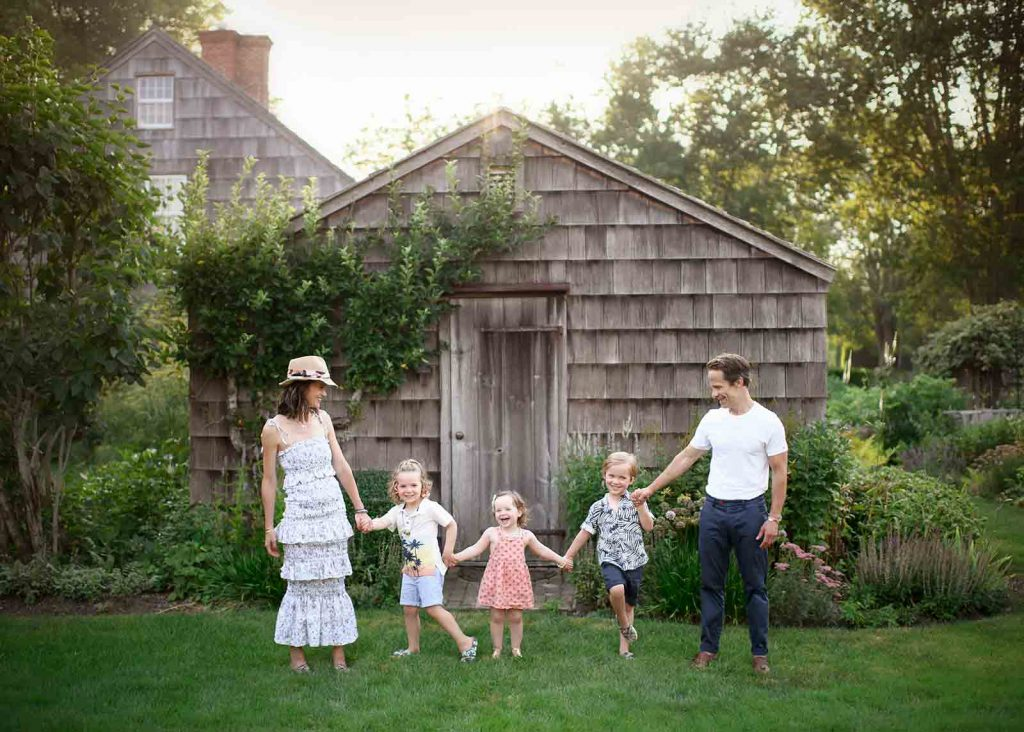 Parents with their children playing happily at a farm in East Hampton