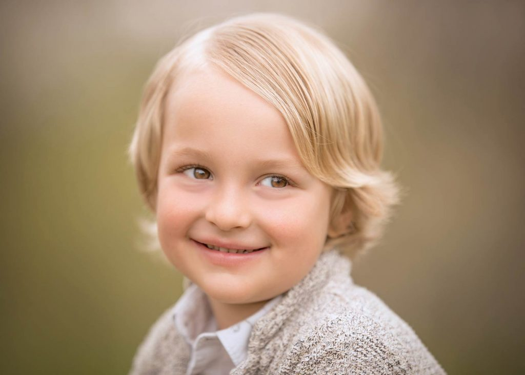 Smiling boy with blonde hair smiling in Sag Harbor NY